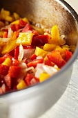 Chopped Onions and Red and Yellow Bell Peppers in a Pot