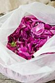 Pink rose petals in a plastic bag