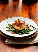 Caramelised sablefish on a bed of green beans (Asia)
