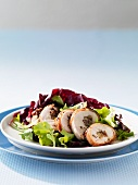 Chicken breast with a data and gorgonzola filling and a mixed leaf salad