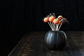 Halloween Cake Pops in a Black Pumpkin