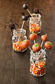 Three Jars with Candy Corn and Halloween Cake Pops