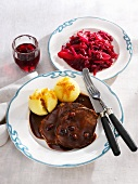 Rhenish Sauerbraten (marinated pot roast) with dumplings and red cabbage