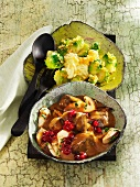 Venison goulash with porcini mushrooms, lingonberries and Brussels sprouts