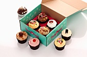 Various cupcakes in a box