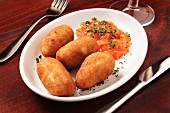 Potato croquettes with tomato sauce