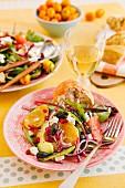 Citrus fruit salad with avocado, feta, olives and pomegranate seeds