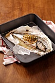 Trout with lemon in parchment paper