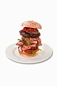 A giant burger with bacon and chilli sauce