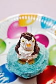 A cupcake decorated with a penguin