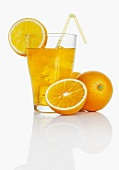 Orangeade and fresh oranges