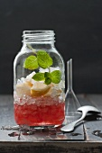 Sangria with crushed ice, lemon and mint in a screw-top jar