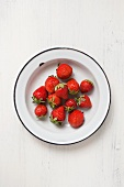 Fresh strawberries in an enamel dish