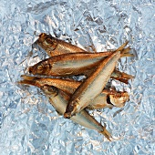 Smoked sprats on aluminium foil