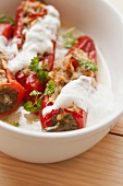 Peppers filled with rice and minced meat with yoghurt sauce