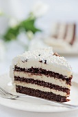 A slice of chocolate cream cake