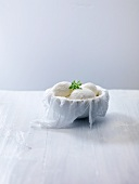 Mozzarella in bowl lined with a muslin cloth