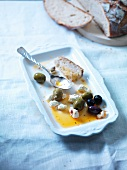 Olives with feta and a slice of bread