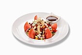 A tomato salad with blue cheese