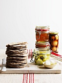 Preserved goods in jars and a stack of crispbread