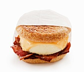 Bacon Egg and Cheese Breakfast Sandwich on an English Muffin; White Background