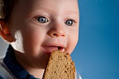 Toddler with a Piece of Whole Wheat Bread