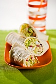 Avocado and Shrimp Wraps on an Orange Dish