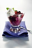 Apples and Berries with Whipped Cream in a Glass Dish