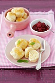 Quark dumplings with buttered crumbs and raspberry sauce