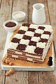 A chessboard cake (coconut and chocolate sponge cake)