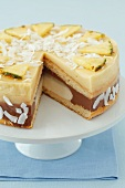 Banana, chocolate and pineapple mousse cake with pineapple and coconut