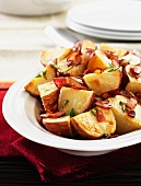 Roast potatoes with bacon and herbs
