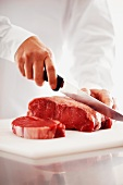 Rib-eye steaks being cut