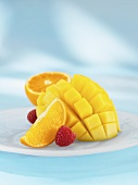 Diced mango with orange and raspberries