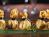 Fried won tons tied with seaweed