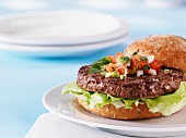 A lean hamburger with tomato salsa