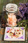 A jar of Himalayan salt and a bunch of lavender