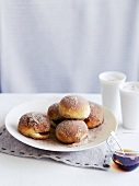 Doughnuts with jam and sugar