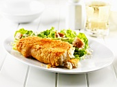 Breaded haddock with salad