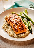 Salmon Fillet with Mustard Sauce Over Rice with Asparagus Spears