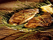 Grilled Trout on Sea Grass; Lemon Wedges