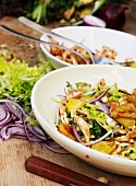 Pineapple salad with chicken and red onions