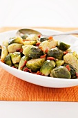 Sauteed Brussels Sprouts with Bacon in a Serving Dish