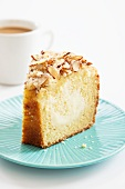 Slice of Almond Coffee Cake; Cup of Coffee
