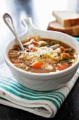 Bowl of Minestrone Soup with Shredded Cheese