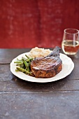 Bone-In Pork Chop with Green Beans and Mashed Potatoes