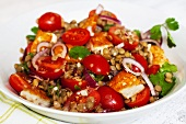 Lentil salad with tomatoes, onions and haloumi