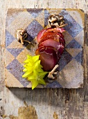 Smoked pork fillet with mushrooms and star fruit