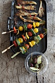 Marinated vegetables kebabs and mushrooms on a barbecue