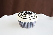 Halloween Cupcake with Spiderweb Decoration